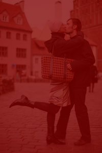 Photo of couple kissing, with red tint