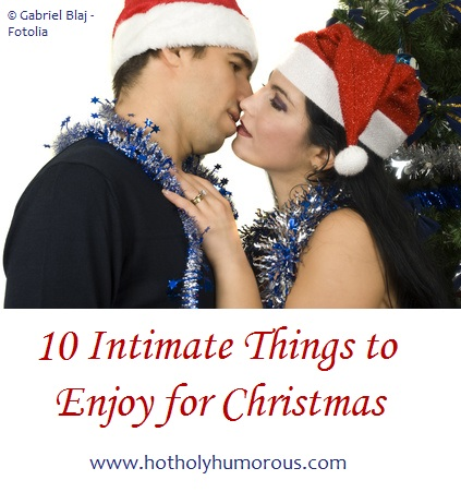 Married Couple in Santa hats, kissing