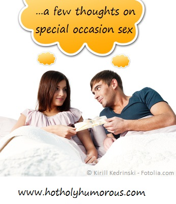 Couple in bed sharing present