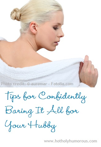 Woman taking off robe - head & shoulders only