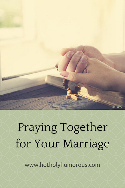 Blog post title + couple holding hands to pray over Bible