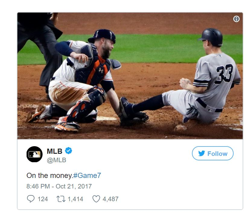 MLB Tweet with photo of Houston Astros catcher tagging out the Yankees runner at home plate