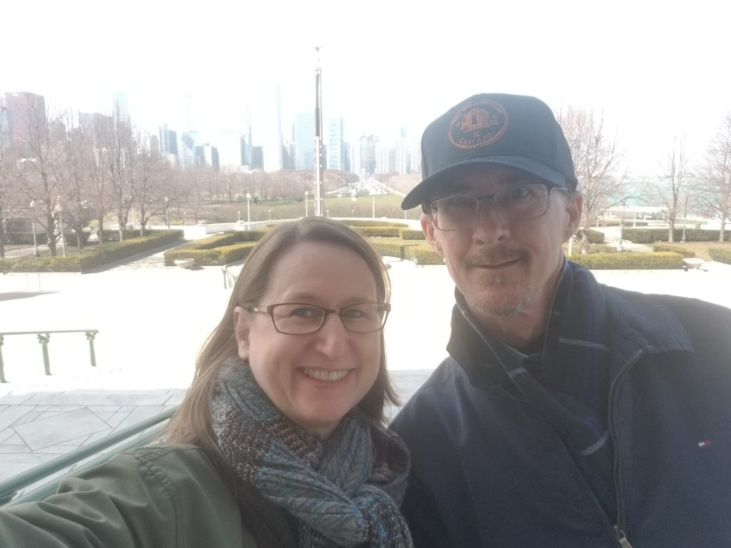 J and Spock on the steps of The Field Museum with Chicago skyline behind them